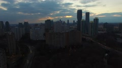 Rising aerial shot towards buildings in city at dawn Stock Footage