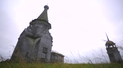 An ancient wooden church and bell tower. Stock Footage