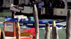 Venice Italy, delivery barge passes a vaporetto (ferry) on the Grand Canal. Stock Footage