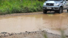 Three russian jeeps are driving through puddles of water. Stock Footage
