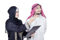 Arabian entrepreneurs looking at something - stock photo
