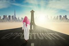 Arabian man with arrow and Opportunity word - stock photo
