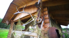 Summerhouse is decorated with net and horns. Stock Footage