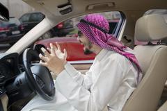 Frustrated Arabian man driving a car Stock Photos