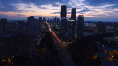 Beautiful sunset viewed from drone while flying towards city Stock Footage