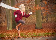 Fashion woman running in fall autumn park forest. - stock photo