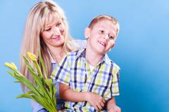 Mother and son celebrate mothers day. - stock photo