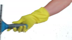 Man with rubber glove wipes cleaning detergent with small squeegee from windo Stock Footage