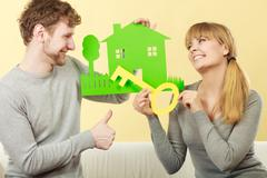 Couple dreaming about new home. Stock Photos