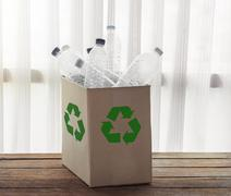 Recycling box filled with clear plastic containers - stock photo
