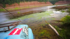 Off road vehicle is driving through the water. Stock Footage