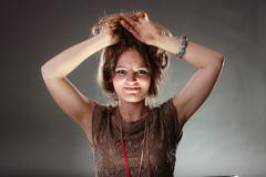 Mysterious enigmatic attractive woman girl. Stock Photos