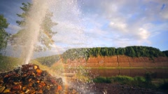 5 meters height geyser and rainbow. Stock Footage