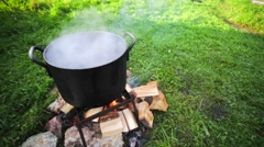 Cooking over the campfire. Stock Footage