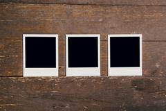 Three vintage frame photo blank on old wood background with space - stock photo