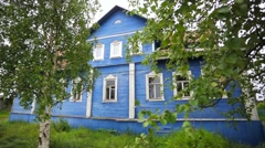 A blue wooden two-storeyed house. - stock footage