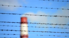 Barbed wire and pipe with smoke Stock Footage