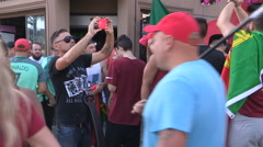 Soccer fans in the streets of Toronto celebrate Portugal world euro cup - stock footage