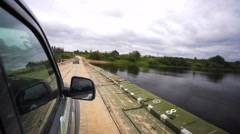 Russian jeeps are crossing the ponton bridge. Stock Footage