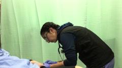 Nurse is drawing blood sample at ER ward inside Eagle ridge hospital - stock footage
