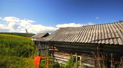 Rural scene. House and meadow. Stock Footage