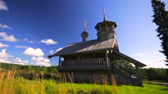 Old wooden chapel on the lake bank Stock Footage