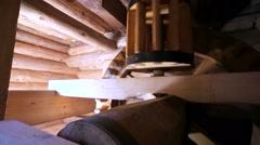 Working wooden mechanism, gear wheel on restored flour mill. - stock footage