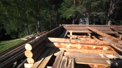 Unfinished block house under the bright sun in the edge of wood. Stock Footage