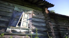 Broken shutters of old and abandobed wooden house. - stock footage