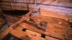 Glidecam of old carpenter's bench with plane. Stock Footage