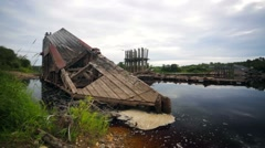 Sceleton of ruined old wooden bridge in north of Russia. Stock Footage