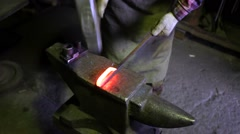 Blacksmith is forging tool in his workshop. Stock Footage