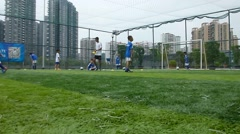 Chinese children are training football skills Stock Footage