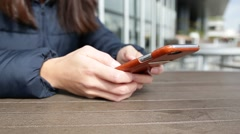 Hands woman using typing on smart phone Stock Footage