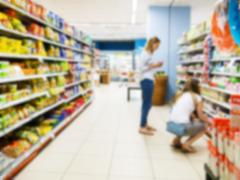 Abstract blurred colorful supermarket aisle Stock Photos
