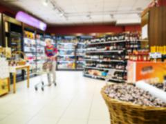 Abstract blurred colorful supermarket aisle - stock photo
