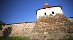 View of walls of Russian Orthodox Solovetsky Monastery made of huge stones. Stock Footage