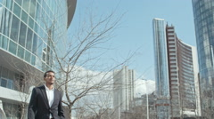 Business Partners in front of Office Center Stock Footage