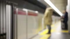 Tokyo underground train stops at a platform and passengers embark and disemba Stock Footage