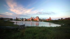 Russian Orthodox Solovetsky Monastery and old wooden boat. Stock Footage