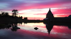 Russian Orthodox Solovetsky Monastery on amazing red sunset. Stock Footage