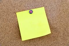 Blank yellow paper note pinned with Great Britain flag thumbtack Stock Photos