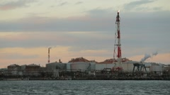 Industrial Scene, Oil tank with seascape - stock footage