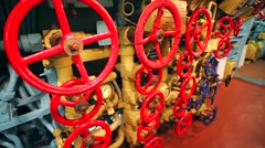 Closeup of red valves in former submarine B-440, closeup of equipment. Stock Footage