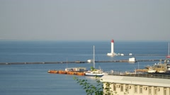 Sea pier. see the lighthouse, the yacht at the pier, sailed yacht. Stock Footage