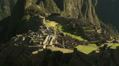 Wide angle tilt up of machu picchu on a misty morning Stock Footage