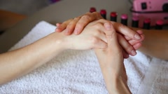 Cosmetician doing hand massage before paints nails of client. Manicure nail care Stock Footage