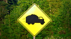 4K Symbol of Moving Heavy Truck on Yellow Traffic Warning Sign, Road Transport Stock Footage