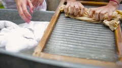 women wash using a old fashioned washboard - stock footage