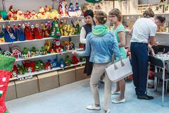 Visitors and exhibitors visiting the stands and exhibits at the exhibition Stock Photos